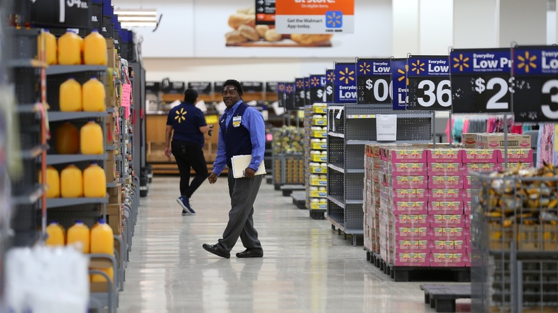 Walmart raises wages to $11/hr, also lays off thousands ofemployees.
